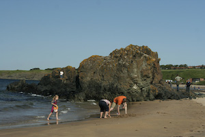 family playing on North Sea Coastline in Berwick Scotland